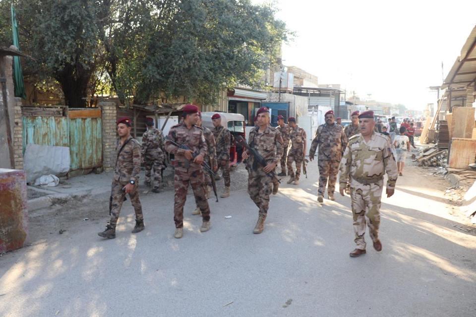 القوات الأمنية تبحث عن الأسلحة في سوق مريدي