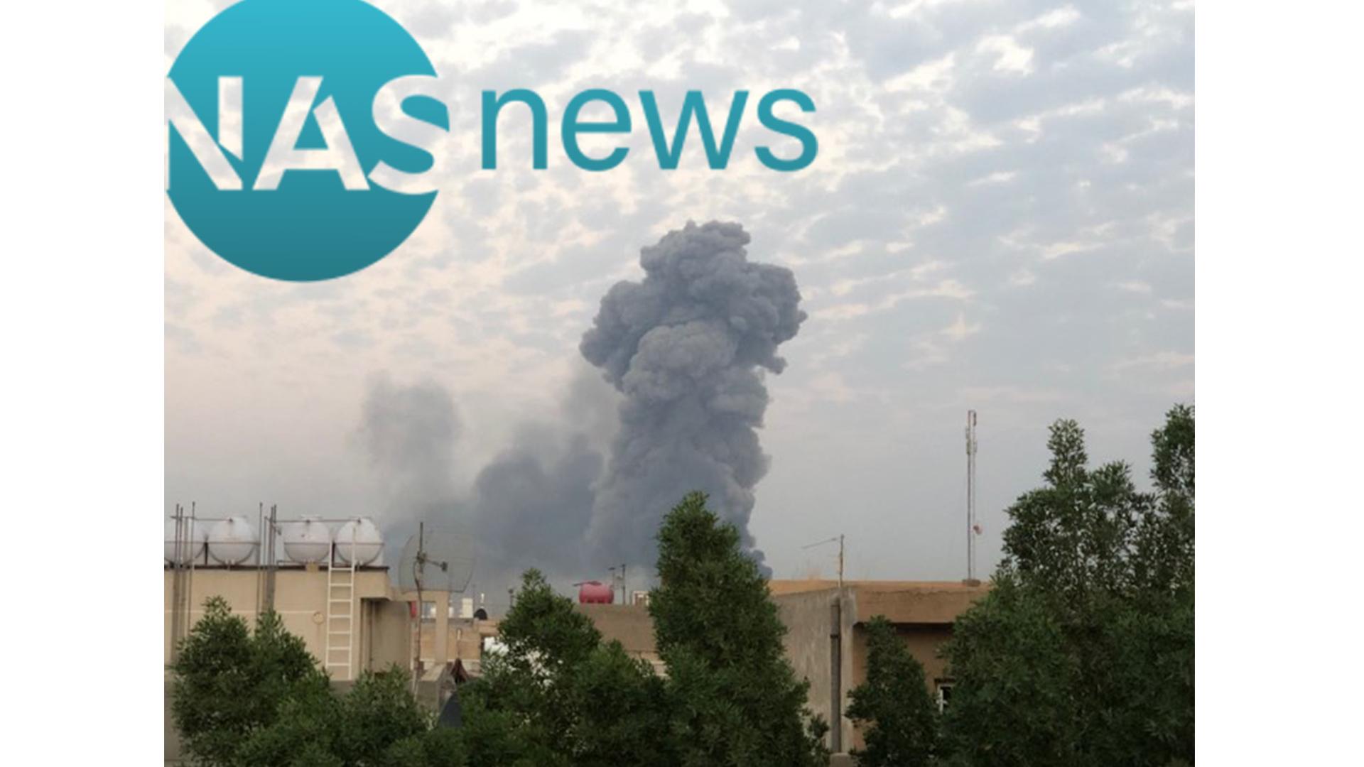 صور لعمود دخان جنوب بغداد بعد انفجار مخزن سلاح