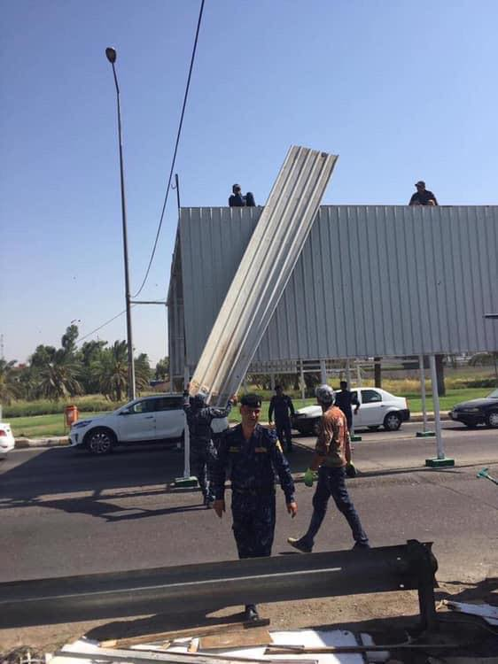 صور: رفع سيطرة مدخل شارع المطار في بغداد