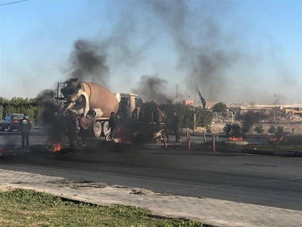غضب في النجف بعد معلومات عن محاولات إعادة تكليف عبدالمهدي برئاسة الحكومة (صور)