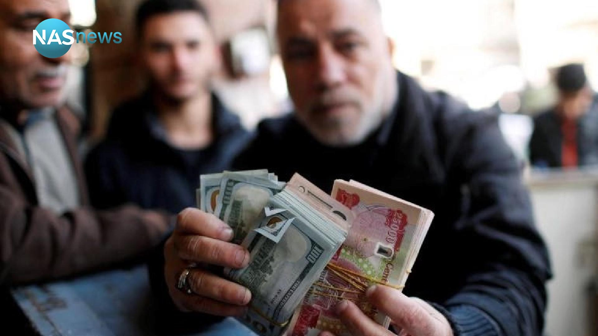 A slight decrease in the exchange rates of the dollar in the Iraqi market