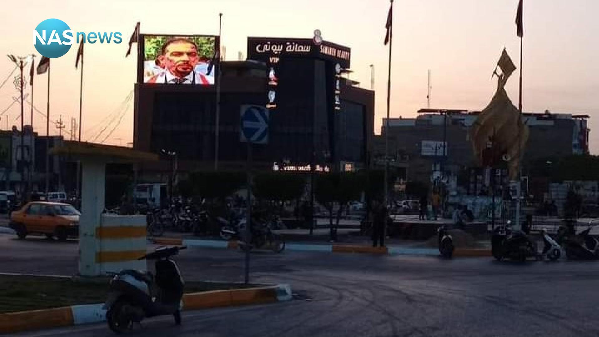 صورة: وجه إيهاب ينير على ساحة الأحرار.. والمتظاهرون يطوّقون القنصلية الإيرانية
