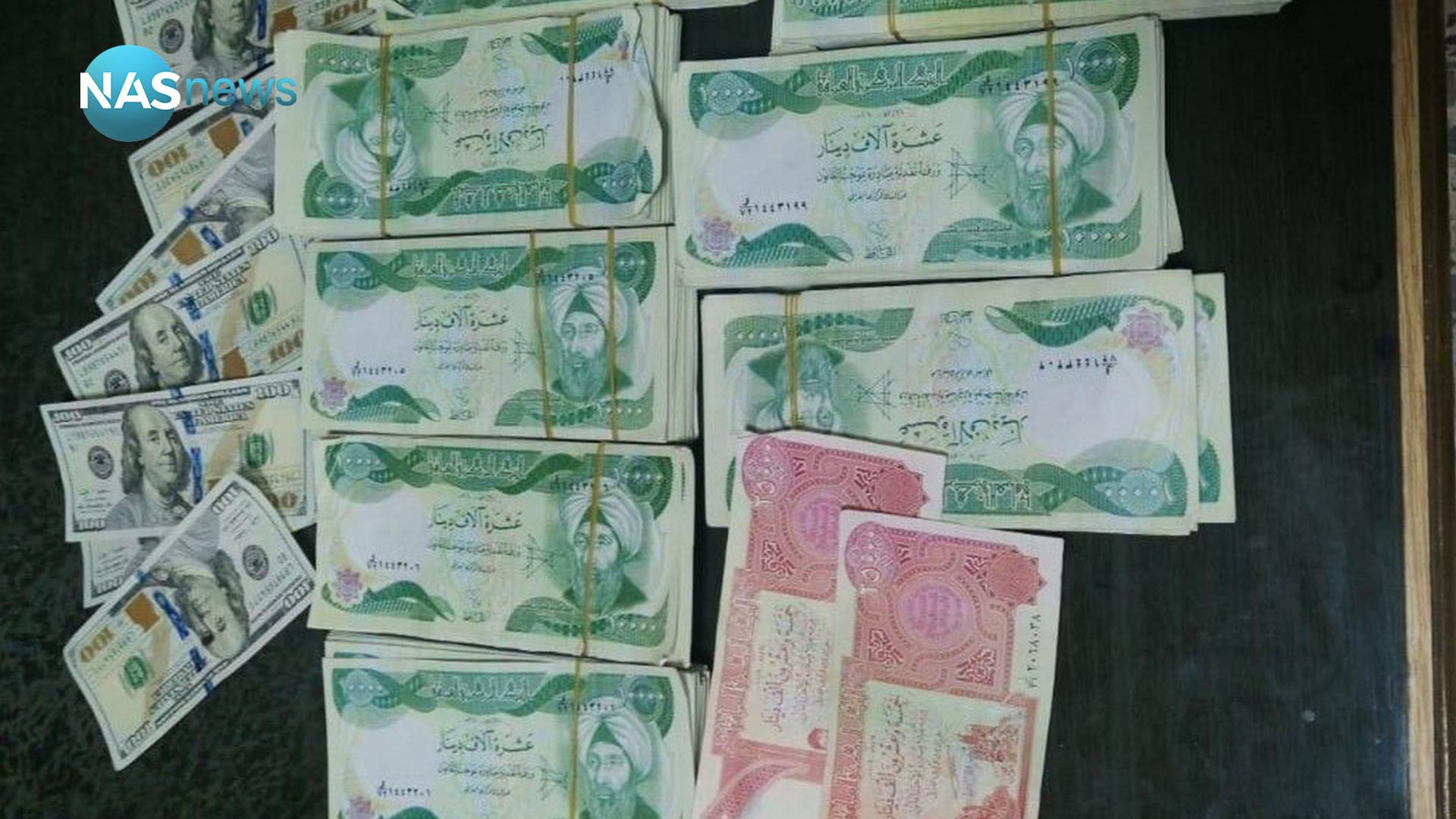 Red and green ... the overthrow of two people with counterfeit amounts in Muthanna (picture) F62464565-45506-202011190532